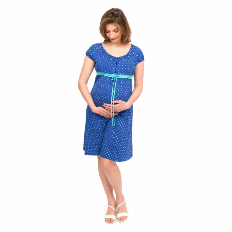 The perfect empire waist maternity dress and nursing dress in cobalt blue with imprinted light blue hearts for all occasions. You will make a statement in this chic summer dress. The soft fabric and flowing cut give your growing baby bump enough space throughout your pregnancy. Contrasting ribbon in green-turquoise at empire waistline under which the nursing access hides. Ideal for discreet breastfeeding. Light and comfortable summer dress for pregnancy, nursing and many summers to come.