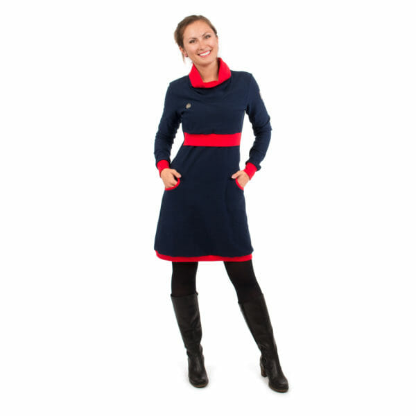 Maternity sweater dress and nursing dress NEELE in navy red - model wears dress and has hands in pockets - front view