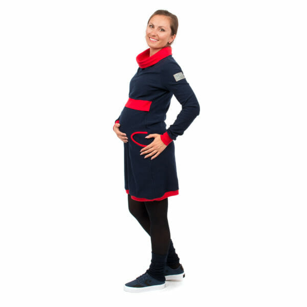Maternity sweater dress and nursing dress NEELE in navy-red - pregnant model with hands under baby bump - side view