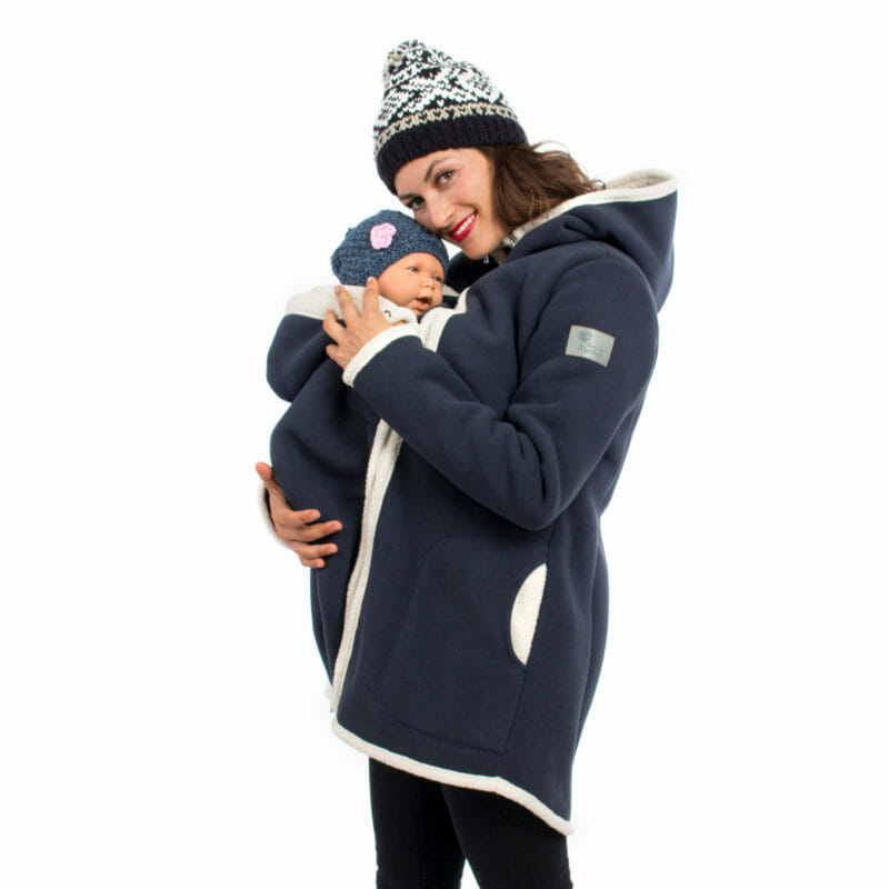 Winter fleece coat in navy with easy to zip-in and out inserts for pregnancy and babywearing. With teddy bear fleece lining in ecru for extra warmth during the cold season. Long and tailored cut will keep baby\'s feet inside the coat and has a feminine look. Adjustable hoods and front zip which closes right to top. Wear without inserts as a casual winter coat for years to come.