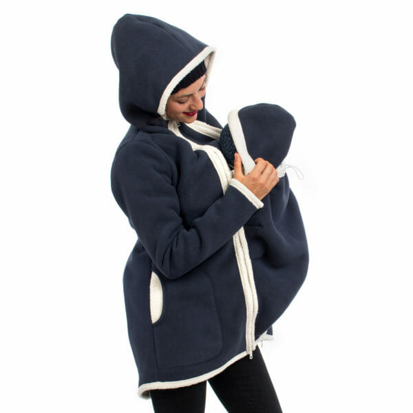 3in1 Maternity and babywearing winter coat fleece ARCTICA in navy - babywearing model wears coat with hood on - baby also with hood on - side view