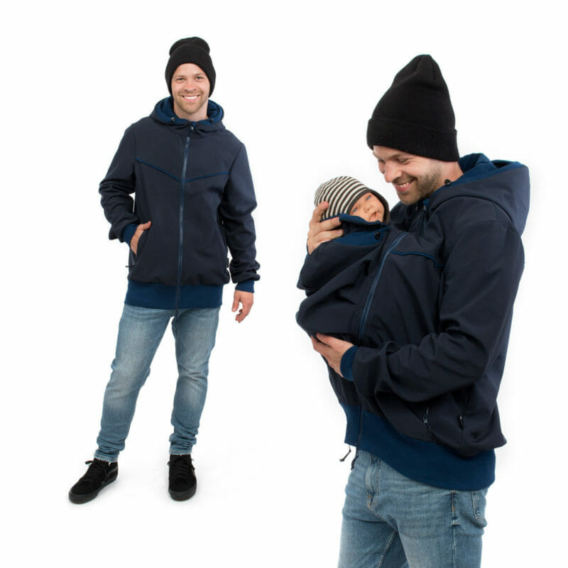 Sporty mens jacket in navy softshell for babywearing and casual outdoor wear. Stylish jacket for modern dads with practical details for a comfortable babywearing experience. Baby and dad are kept warm and cosy when out and about on walks whatever the weather. Comes with easy to zip-in insert for baby carrying with adjuastable hood and neck protection. Jacket features deep pockets with zipper to keep your valuables safe, chin protection at top of front zipper and adjustable hoods.