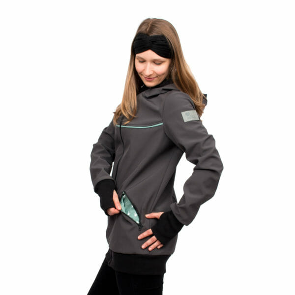4in1 babywearing coat softshell AVENTURIS in gray-mint - model wears coat and shows pocket with lining - side view