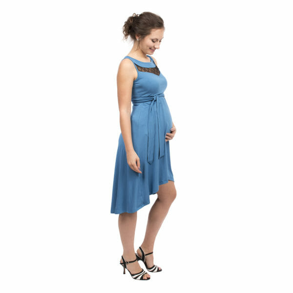Maternity and nursing cocktail dress ALMA in blue with black lace - pregnant model with hand under her baby bump - side view