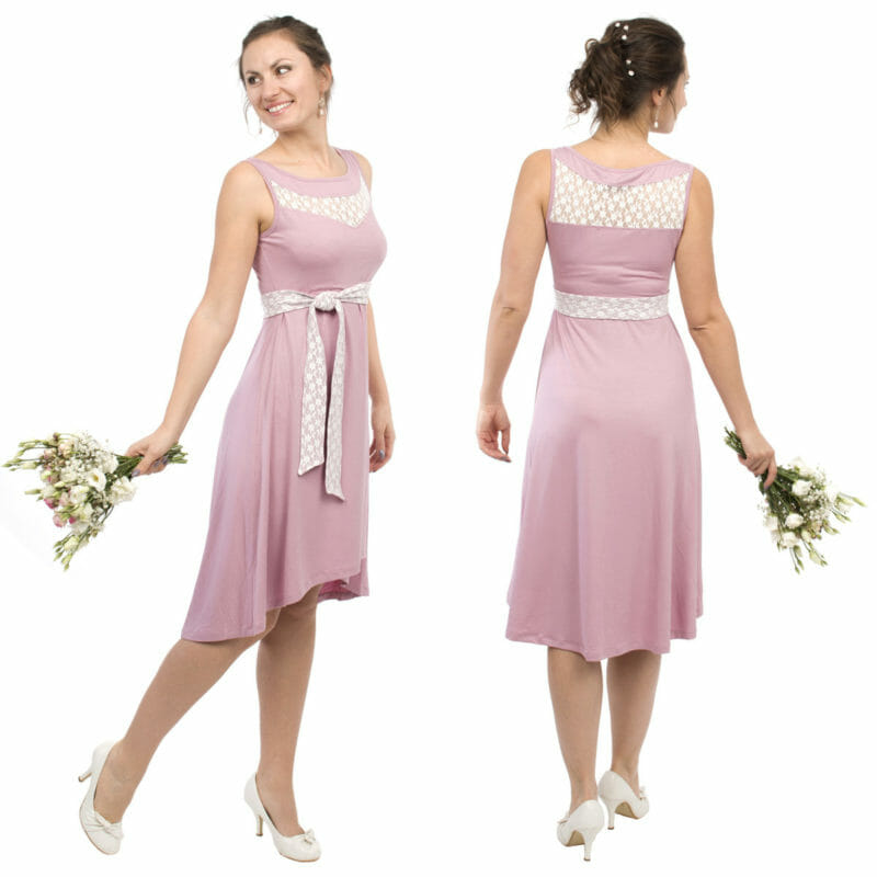 Beautiful maternity and nursing cocktail dress in pink with white lace inset. Perfect dress when you are invited at a wedding, christening or any other more formal occasion. The dress is sleeveless with lace inset at top and back. The skirt ends above knee and is longer at back. Comes with belt which has lace on one side so that you can choose which side to show. Invisible nursing access. Very comfortable and stylish occasion wear.