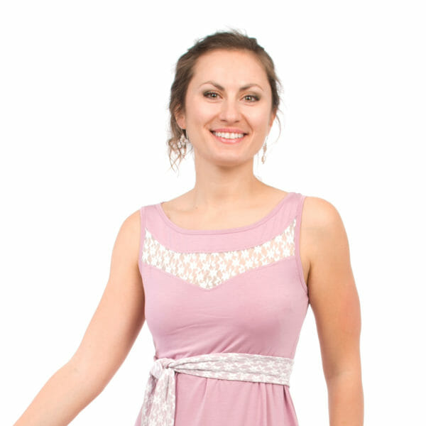 Maternity and nursing cocktail dress ALMA in pink with white lace - model wears dress - detailed view of top with lace