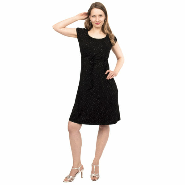 Empire-waist maternity and nursing dress ELLI in black-silver - model wears dress and has one hand in her hip and other on her head - front view