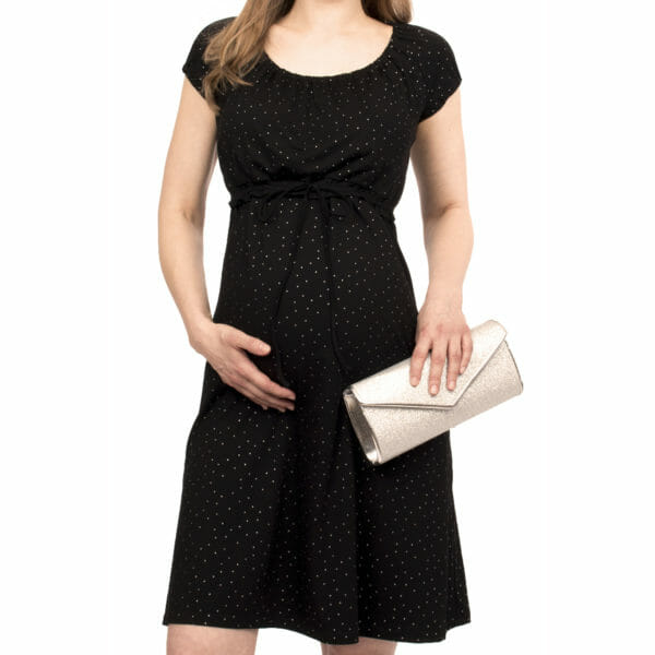 Empire-waist maternity and nursing dress ELLI in black-silver - pregnant model wears dress and has silver clutch in her hand - close-up