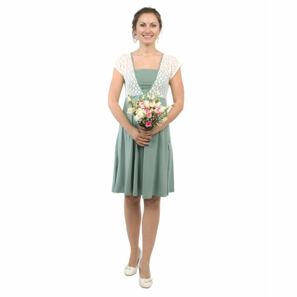 White lace top maternity and nursing dress JULIETTE in mint - model wears dress and holds bunch of flowers in front of her