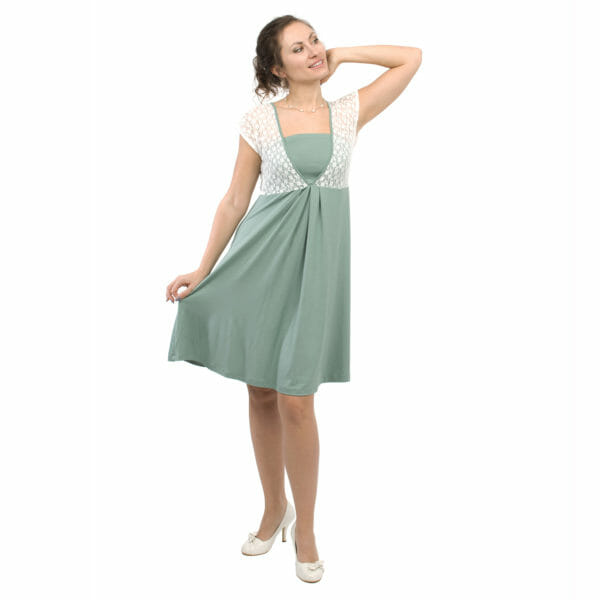 White lace top maternity and nursing dress JULIETTE in mint - model wears dress with hand on skirt and other hand on head - front view