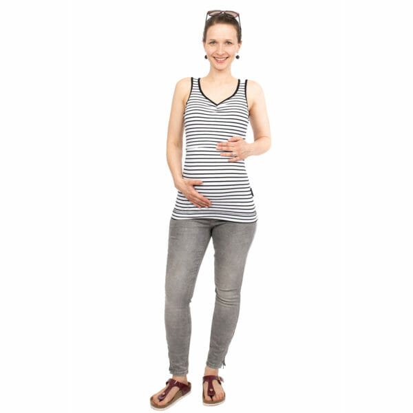 Maternity and nursing tank top SOLEA in black-white-stripes - pregnant model with hands on baby bump - full front view