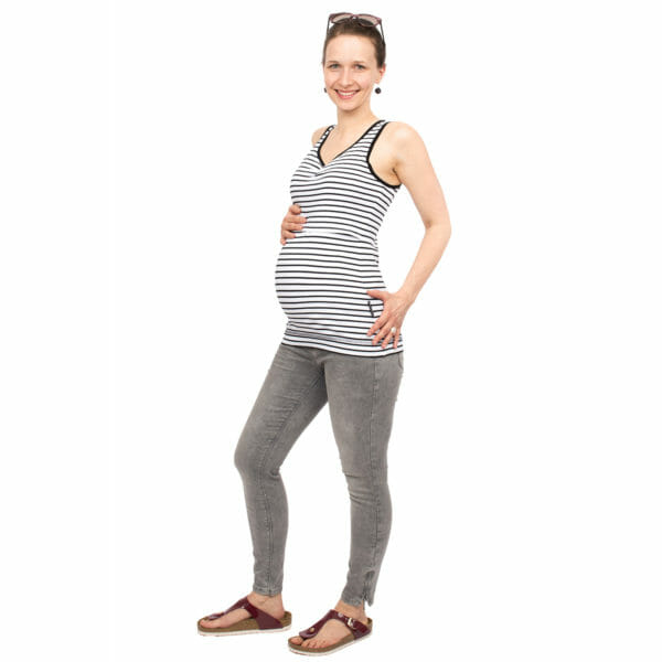Maternity and nursing tank top SOLEA in black-white-stripes - pregnant model wears top - side view