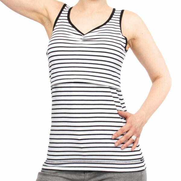 Maternity and nursing tank top SOLEA in black-white-stripes - model wears top - close-up view of front of top