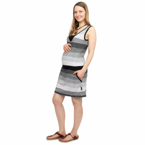 Casual maternity and nursing summer dress COSTA in black-white - pregnant model wears dress and has one hand on baby bump and other hand in pocket