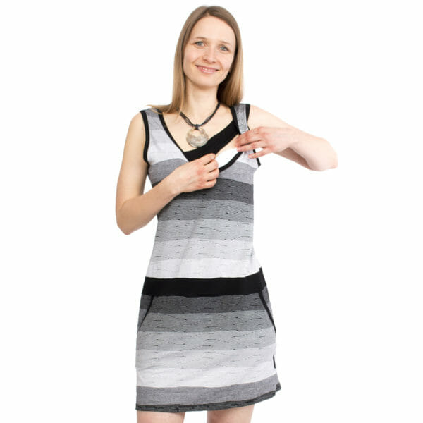 Casual maternity and nursing summer dress COSTA in black-white - model wears dress and shows breastfeeding access