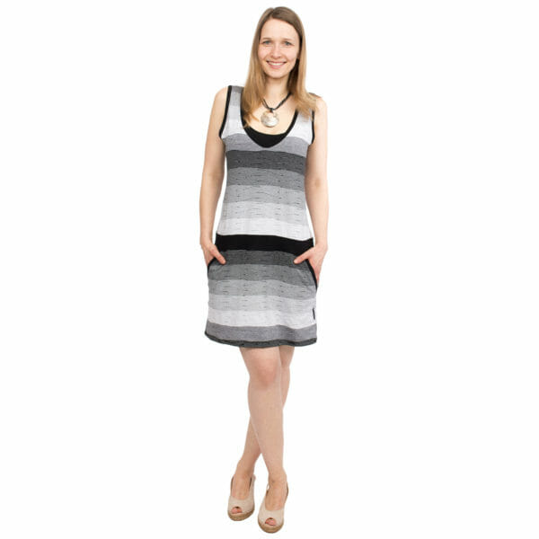 Casual maternity and nursing summer dress COSTA in black-white - model wears dress and has both hands in pockets - full front view