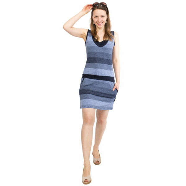 Casual maternity and nursing summer dress COSTA in navy - model wears dress with one hand holding sun glasses on head and other hand in pocket - front view