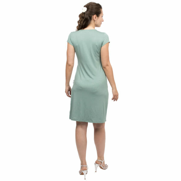 Festive maternity and nursing dress SAMSARA in mint-silver - model wears dress with silver sandals - view from back