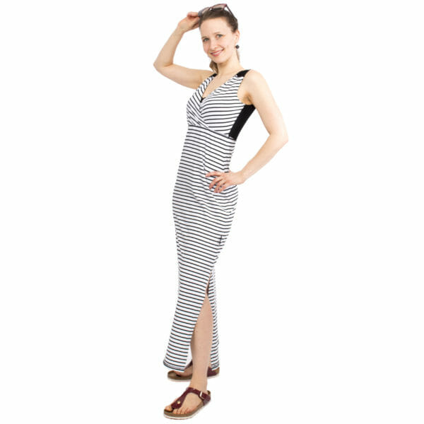 Maternity and nursing maxi dress KAYA in black-white stripes - model wears dress and has hand on head holding sun glasses - side view with slit