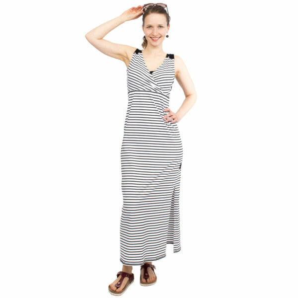 Maternity and nursing maxi dress KAYA in black-white stripes - model wears dress and has han on head holding sun glasses - front view