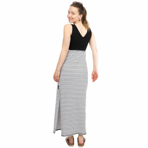 Maternity and nursing maxi dress KAYA in black-white stripes - model wears dress - view from back