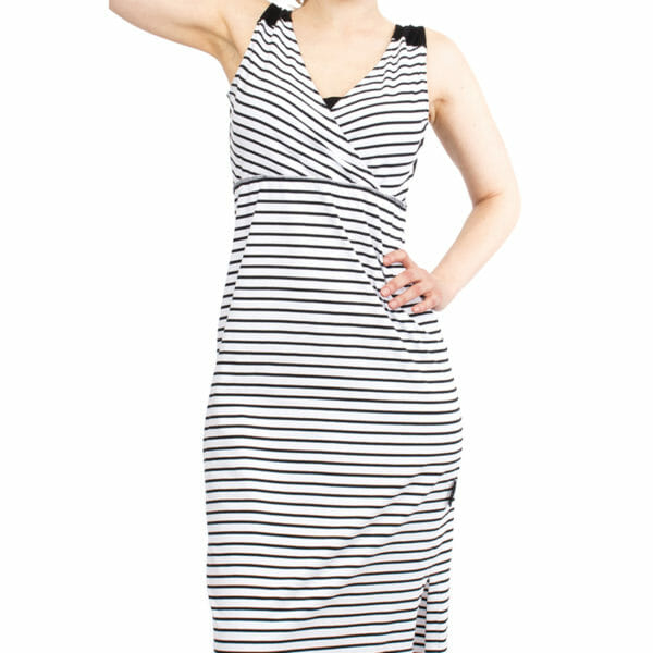 Maternity and nursing maxi dress KAYA in black-white stripes - model wears dress - detailed view of front