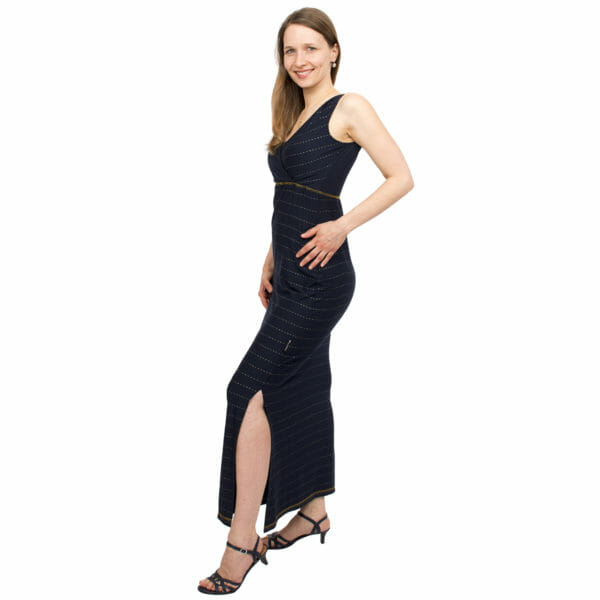 Maternity and nursing maxi dress KAYA in night-blue with golden pine stripes - model wears dress and shows slit - side view