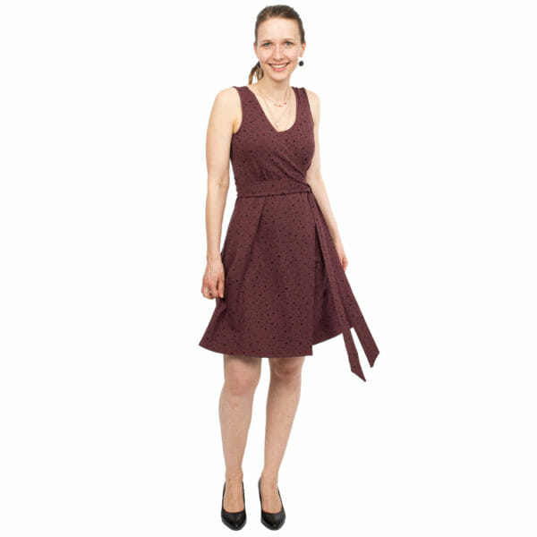 Maternity and nursing wrap dress TESSA in cassis with black dots - model wears dress - front view