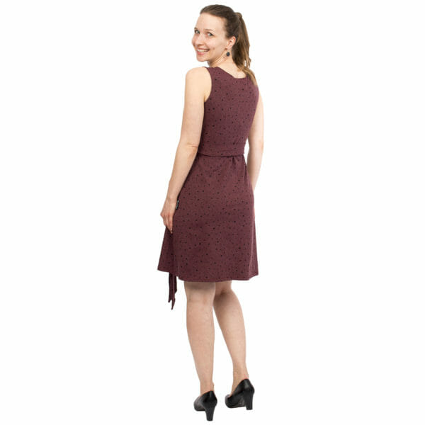 Maternity and nursing wrap dress TESSA in cassis with black dots - model wears dress - view from back