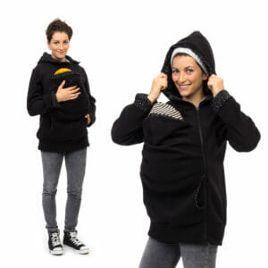 Babywearing jacket AHOI in black with cosmos print - babywearing model on left hand side with hand on baby's back and on right hand side with hood on
