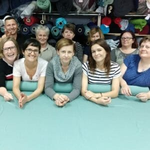 The team in our sewing shop in Poland with Gunda and Katja on the left