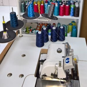 Workplace where we sew your clothes - sewing machine and yarn