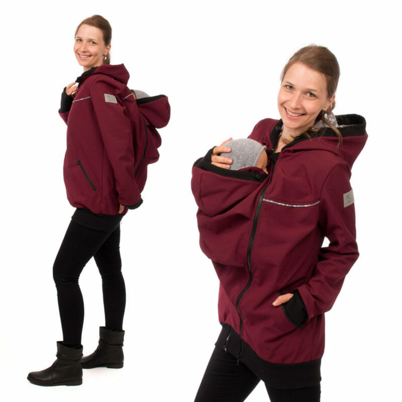 4 in 1 babywearing coat made of breathable allweather softshell in bordeaux. The jacket comes with two easy to zip-in inserts to use as maternity jacket and for front or back carrying your baby. With adjustable and lined hoods, deep pockets with zip and contrasting edgings. The arms are long with warm ribbed cuffs and thumbholes. The babywearing insert design allows to be wrapped around baby and can be worn open or closed with buttons. #vivalamama