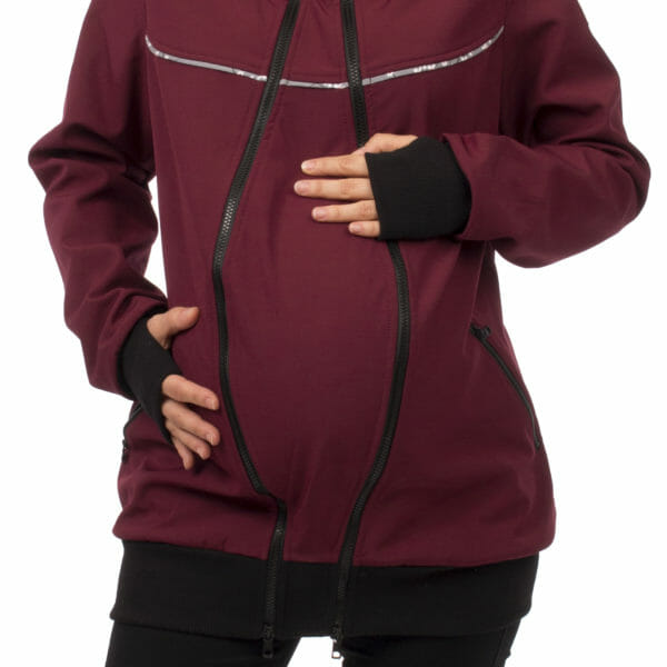 4in1 babywearing coat softshell AVENTURIS in bordeaux - pregnant model wears coat with pregnancy insert - close up