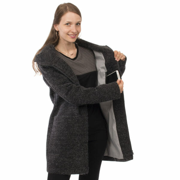 3in1 winter maternity and carrying coat VALENTIN in anthracite - model wears coat without insert and shows inner pocket for mobile