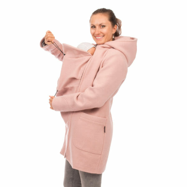 3in1 winter maternity and carrying coat VALENTIN in pink - babywearing model wears coat with carrying insert and adjusts width of insert and baby's hood on insert