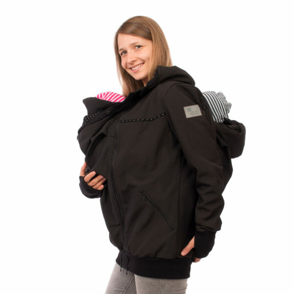 Twin baby carrier jacket TWINSTAR in black - babywearing model wears jacket with inserts at front and back - detailed side view