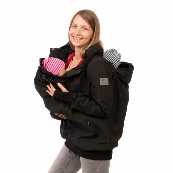 Twin baby carrier jacket TWINSTAR in black - babywearing model wears jacket with insert front and back - detailed view