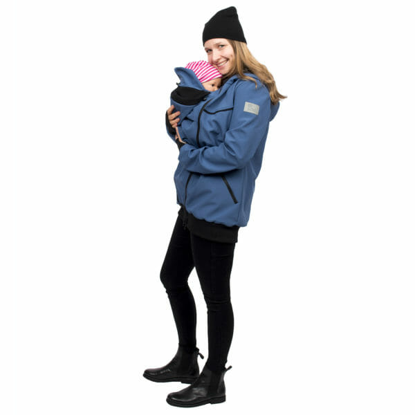 Twin baby carrier jacket TWINSTAR in jeans-blue - model wears jacket with one baby in insert on front - side view