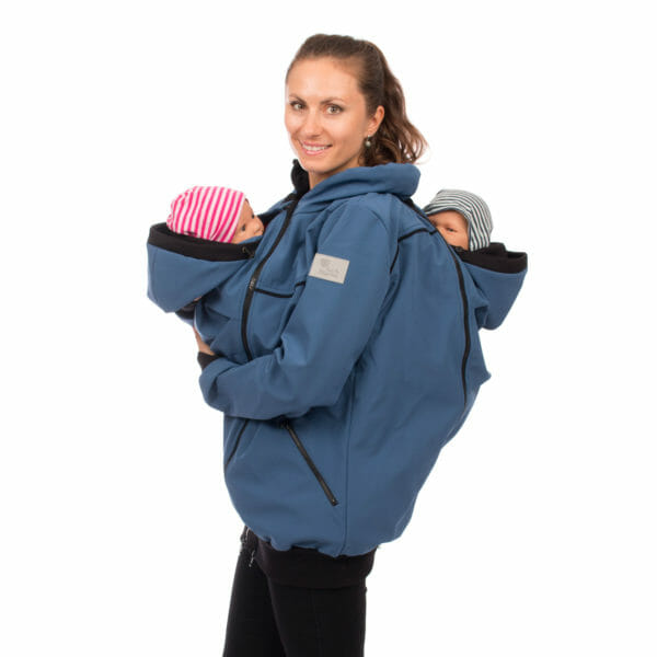 Twin baby carrier jacket TWINSTAR in jeans-blue - model wears jacket with babies in inserts on front and at back - side view