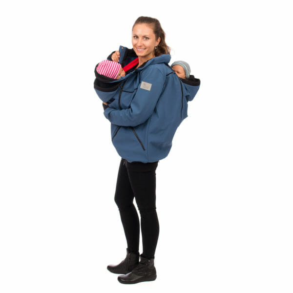 Twin baby carrier jacket TWINSTAR in jeans-blue - model wears jacket with babies in inserts on front with open button and at back - side view