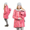 Babywearing and maternity parka coat PINA in coral - model on the left wears coat with baby in babywearing inset at back and on the right with babywearing insert at front