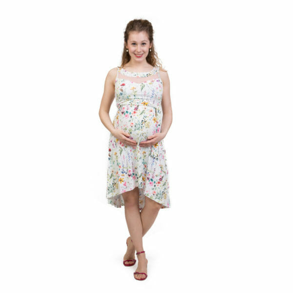 Maternity and nursing cocktail dress ALMA in spring flowers-pink lace - pregnant model wears dress and holds hands under her baby bump - front view